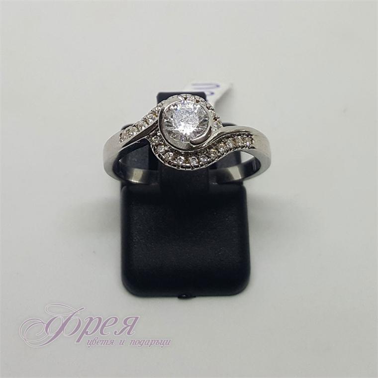 Сребърен пръстен - кръгъл камък с извити форми около него
